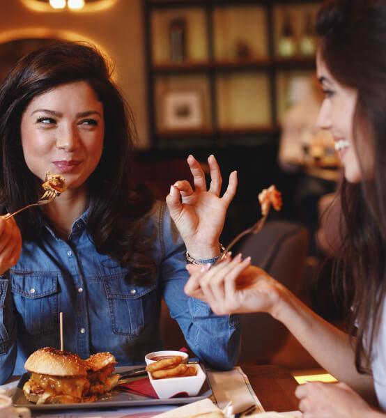 two ladies talking while eating