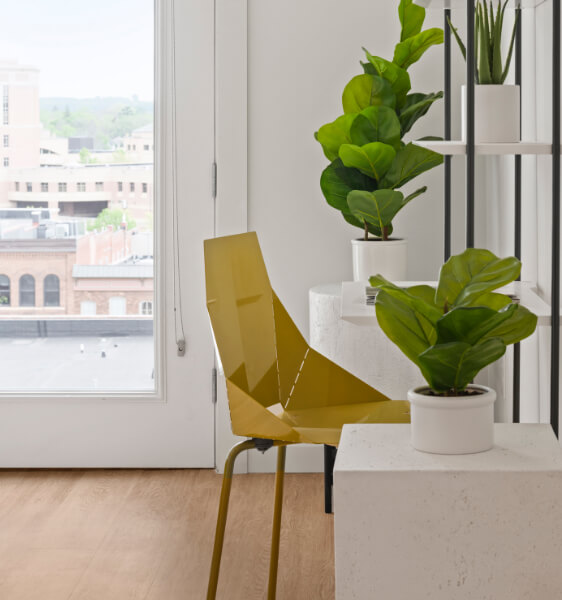 a modern golden chair in the apartment